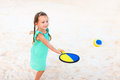 Little girl playing beach tennis adorable Royalty Free Stock Images
