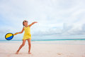 Little girl playing beach tennis on vacation Stock Photos