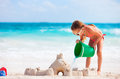 Little girl playing at beach tropical making sand castle Royalty Free Stock Images