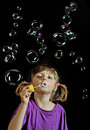 Little girl playing - blowing soap bubbles Stock Image