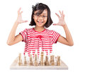 Little girl playing chess iv thinking hard stone made over white background Stock Photography