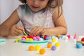 Little girl playing with colorful balls Royalty Free Stock Photo