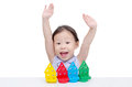 Little girl playing colorful wood blocks Royalty Free Stock Photo