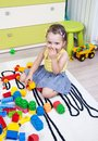Little girl playing with cubes of plastic in his room Stock Photos