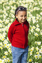 Little Girl Playing In Daffodils Stock Photos
