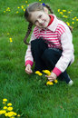 Little girl playing with dandelions Royalty Free Stock Photo