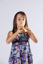 Little girl playing flute Stock Photos