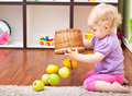 Little girl playing with fresh fruits Royalty Free Stock Images