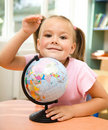 Little girl is playing with globe Royalty Free Stock Image