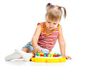 Little girl playing with mosaic toy Royalty Free Stock Photo