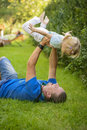 Little girl playing outdoor with her father sweet baby dad on a sensory garden enjoying nature outdoors activity family portrait Stock Image