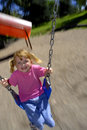 Little Girl Playing at Park Royalty Free Stock Photos