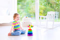 Little girl playing with a pyramid Royalty Free Stock Photo