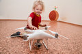 Little girl playing with quadrocopter Royalty Free Stock Photo
