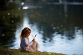 Little girl playing on the river bank Royalty Free Stock Photo