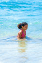Little girl playing in sea water blue Royalty Free Stock Photo