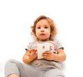 Little girl playing with smartphone on white background Stock Photos