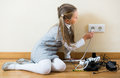 Little girl playing with sockets at home Royalty Free Stock Photo