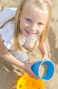 Little girl playing with toys in sandbox Royalty Free Stock Images