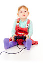 Little girl playing video games on the joystick