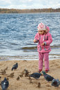 Little girl plays beach in autumn day Royalty Free Stock Photo