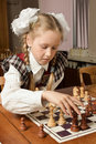 image photo : Little girl plays chess