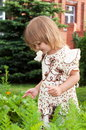 Little girl plays in garden Royalty Free Stock Photography