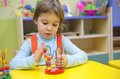 Little girl plays in kindergarten Stock Image