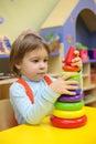 Little girl plays in kindergarten Stock Photography