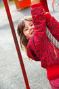 Little girl plays in playground Stock Image