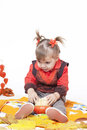Little girl plays with  pumpkins Stock Photo