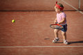Little girl plays tennis Royalty Free Stock Photo