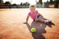 Little girl plays tennis funny outside photo Stock Photography