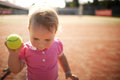 Little girl plays tennis funny outside photo Stock Images