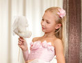 Little girl plays with wedding teddy-bear Royalty Free Stock Photo