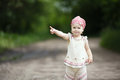 Little girl points up beautiful outdoors photo Stock Images