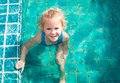 Little girl in the pool Stock Image