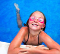 Little girl in pool with goggles beautiful smiling pink Royalty Free Stock Photos