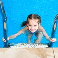 Little girl in the pool happy floating on lifebuoy Royalty Free Stock Photography