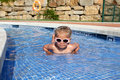 Little girl in the pool with sun glasses having fun Stock Photography