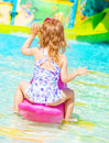 Little girl in poolside rear view of sweet wearing beautiful swimwear having fun on water attractions aquapark happy childhood Stock Images