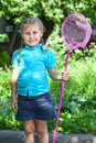 Little girl portrait with butterfly net Royalty Free Stock Photo