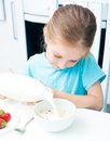 Little girl pouring milk cute in cereal Stock Image