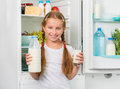Little girl pouring milk in glass Royalty Free Stock Photo