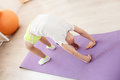Little girl practicing yoga look how i can top view of doing gymnastics exercise on fitness mat Royalty Free Stock Images
