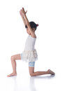 Little girl practicing yoga white background Stock Photos