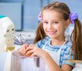 Little girl is preparing an apple pie happy in the kitchen at home Stock Images