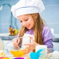 Little girl preparing cookies happy in the kitchen Stock Photography
