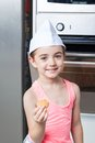 Little girl preparing taking cookies Royalty Free Stock Photo