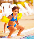 Little girl preparing to jump into water cute having fun in the pool luxury beach resort summer time in daycare holiday and Stock Photos